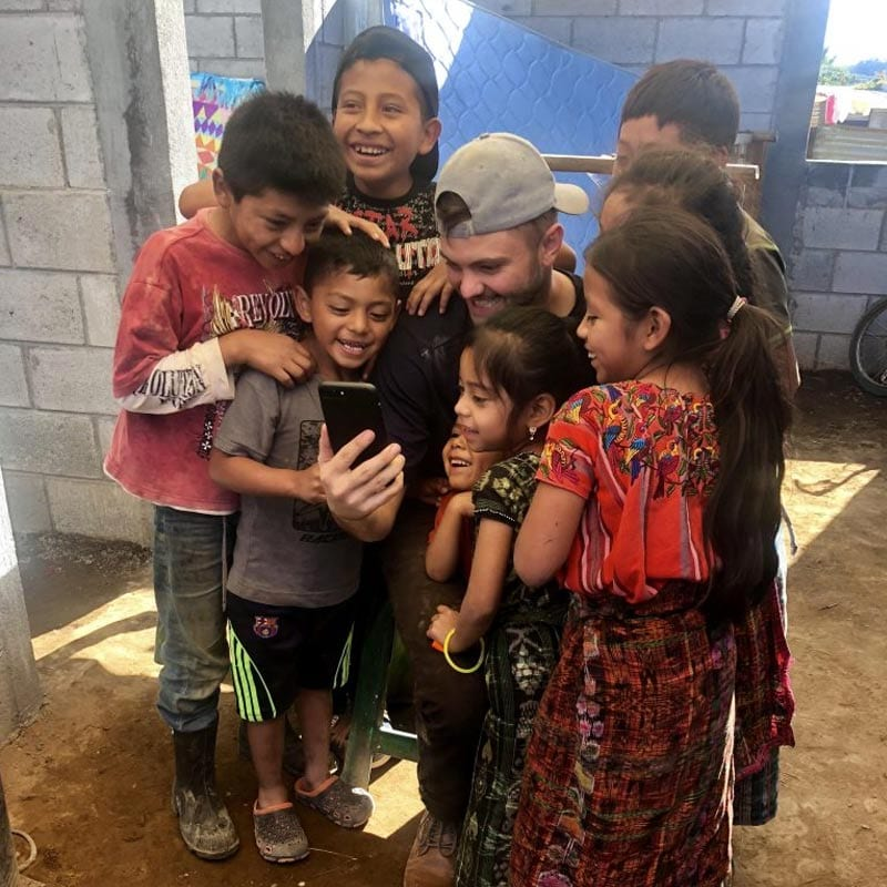 Paul with local kids in Guatemala
