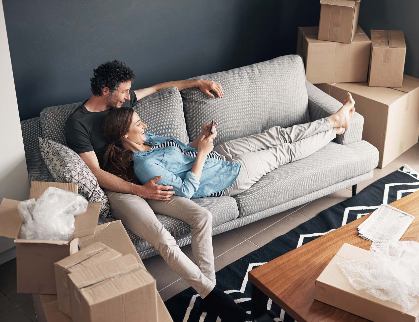 Experienced buyers relaxing in their new home